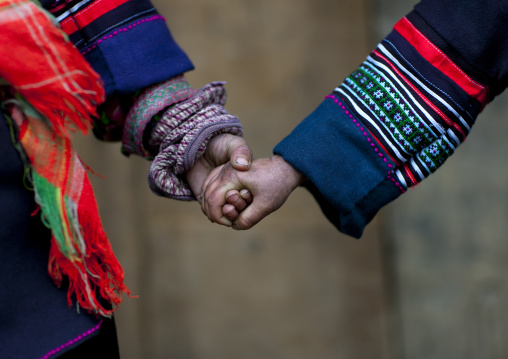 Black hmong kids holding each other s hand, Sapa, Vietnam