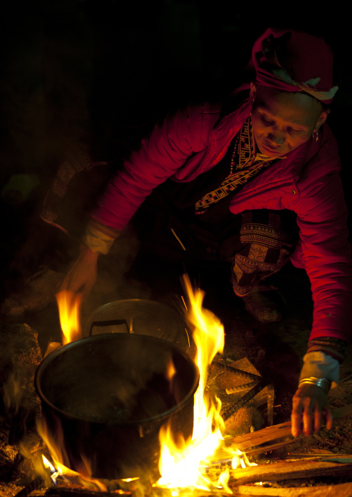 Red dzao woman cooking, Sapa, Vietnam