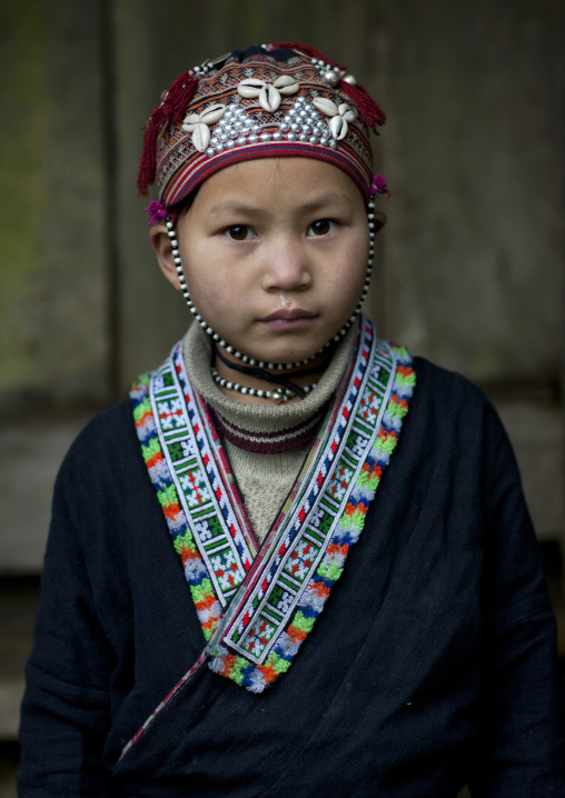 Young red dzao girl in traditional clothes, Sapa, Vietnam