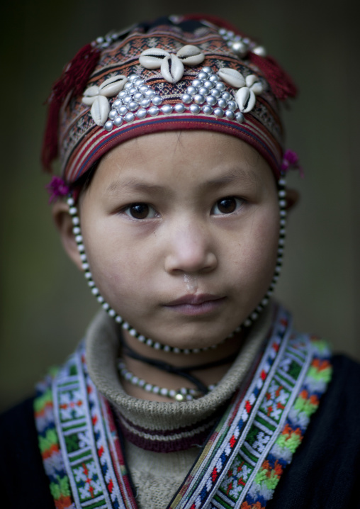 Young red dzao girl with a traditional hat, Sapa, Vietnam