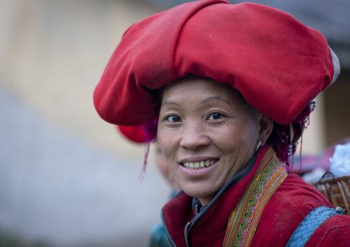 Red dzao woman with a red headgear, Sapa, Vietnam