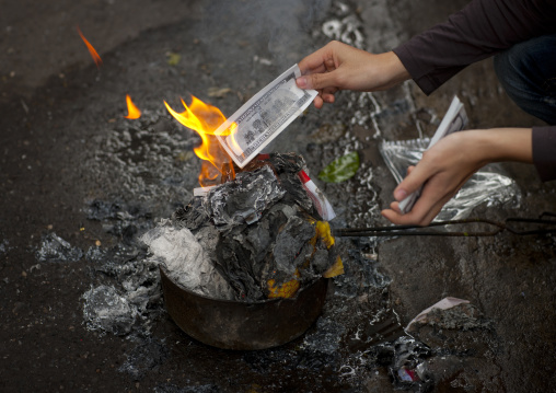 Burning a note as an offering on tet day hanoi, Vietnam