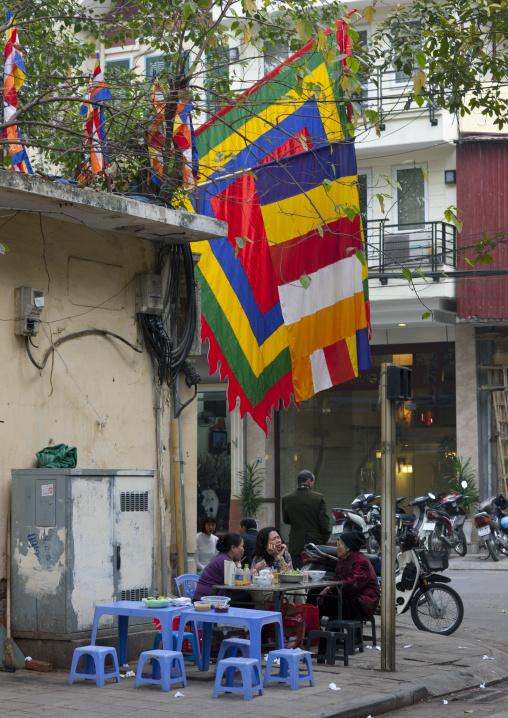 Women eating on the street, Hanoi, Vietnam