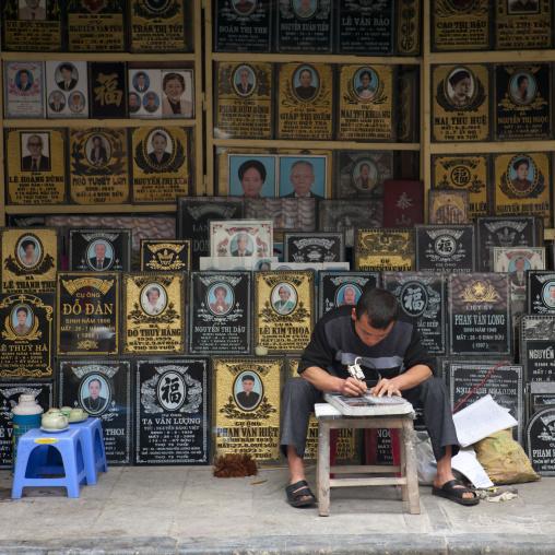 Man engraving a gravestone, Hanoi, Vietnam
