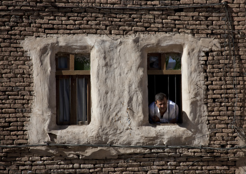 Man Looking Out From The Window Of A Typical Residential House, Sana, Yemen