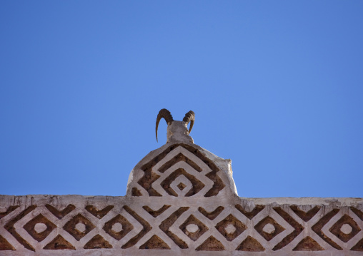 Ibex Horns On The Top Of A Traditionnaly Sculpted Roof In Sanaa, Yemen