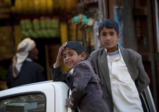Two Boys Leaning On A Car In The Street, Sanaa, Yemen