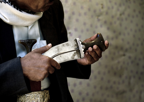 Man Checking The Pommel Of A Jambiya, Yemen