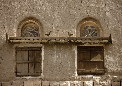 Stained Glass Windows And Wooden Birds Over Shutted Windows, Amran, Yemen