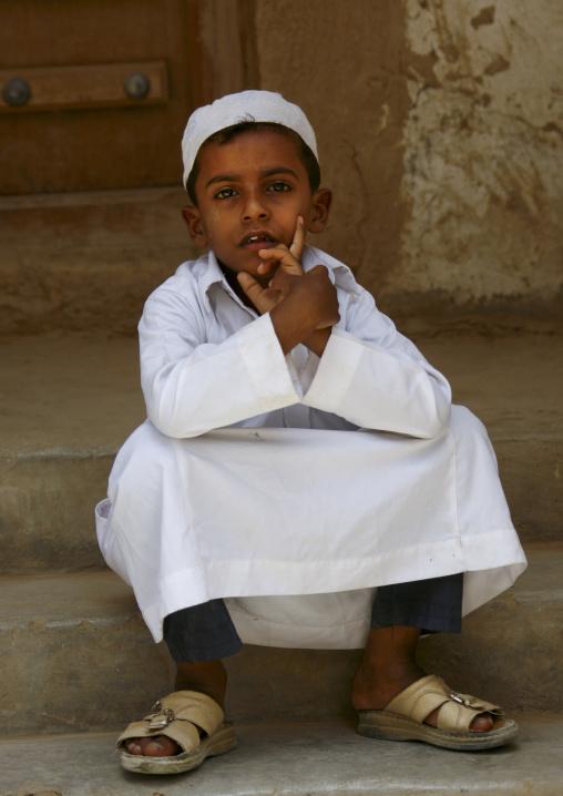 Yemeni Boy With White Taqiyah Sitting On Doorstep, Tarim, Yemen