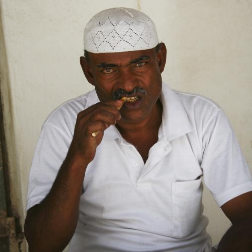 Yemenni Man With White Taqiyah Chewing A Toothbrush Stick, Tarim, Yemen