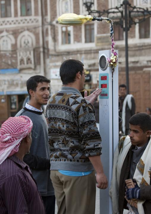 Men Weighing Themselves In Sanaa Souq, Yemen