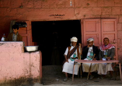 Three Men Sitting In Front Of A Table At A The Terrace Of A Coffee Shop, Amran, Yemen