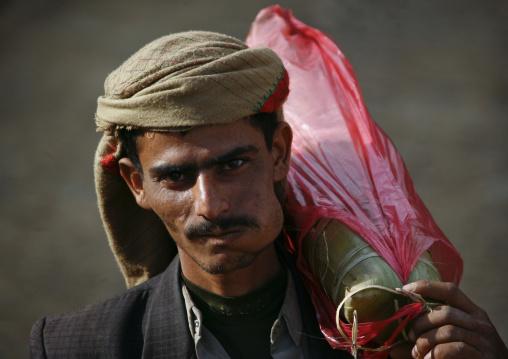 Shahara Man Chewing Kat And Carrying A Bag On His Shoulder, Shahara, Yemen