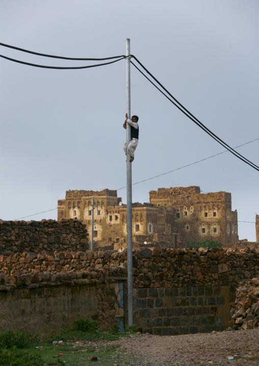 Boy Climbing On A Telephone Pole, Shahara, Yemen