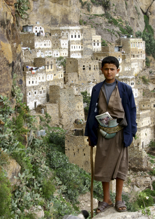 Boy In A Suit Carrying A Jambiya And Standing In Front Of The Cliff, Al Hajjara, Yemen