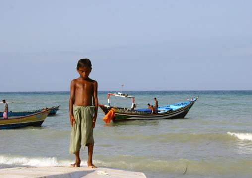 Serious Yemeni Kid Standing On A Beach, Al Khukaha, Yemen