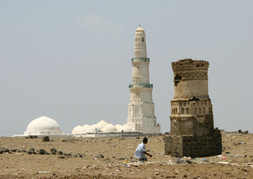Man Passing By The Remains Of A Tower With A White Mosque In The Background, Mocha, Yemen