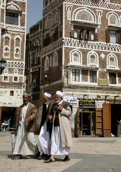 Three Men Walking Through The Bab Al Yemen, Sanaa, Yemen
