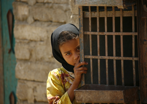 Shy Yemeni Girl Hiding Behind An Iron Door, Shahara, Yemen