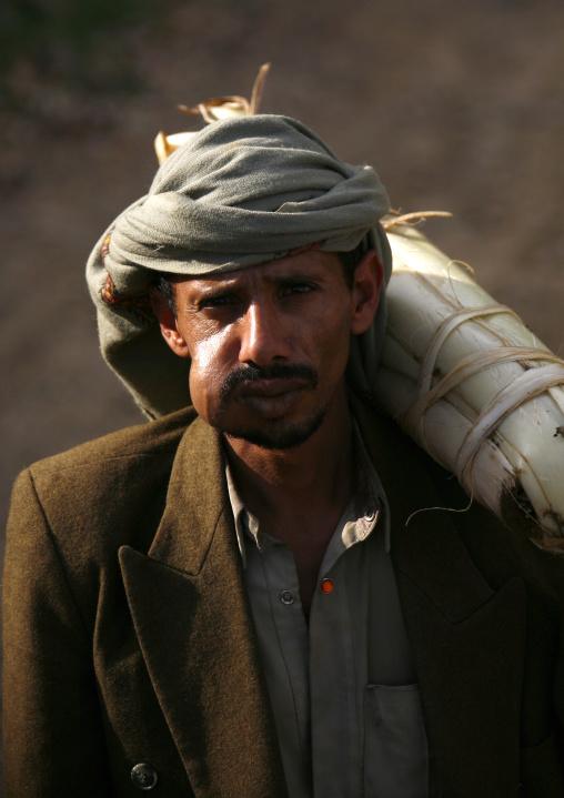 Khat Chewer Carring A Package On His Shoulder Under The Sun Light, Shahara, Yemen
