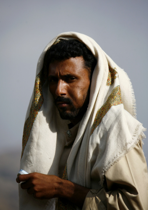 Man Chewing Khat With Traditional Scarf And Mobile Phone, Shahara, Yemen