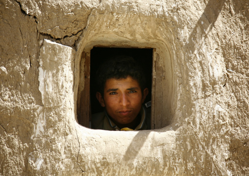 Young Boy Looking Out From A Small Window, Amran, Yemen