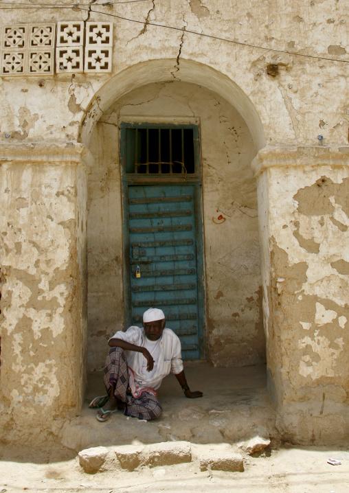 Man With White Taqiyah Sitting On The Ground And Looking At Camera, Tarim, Yemen