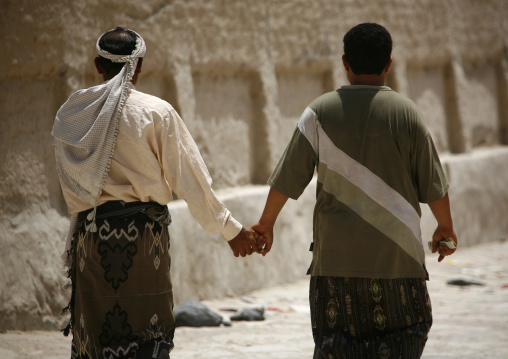 Two Men Holding Hands As A Sign Of Friendship, Tarim,  Yemen