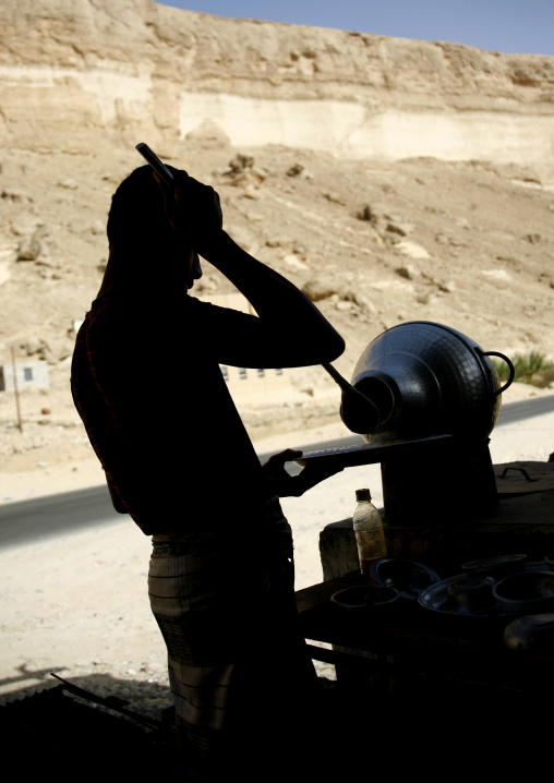 Man Preparing Foul Meal In A Restaurant Along The Road, Yemen