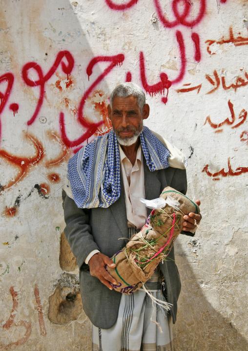 Qat Seller Holding A Bag Of Qat, Seiyun, Yemen