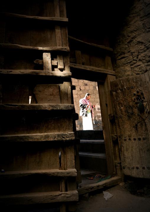 Man Speaking In The Street Seen From The Interior Of A House, Behind A Heavy Wooden Door, Sanaa, Yemen