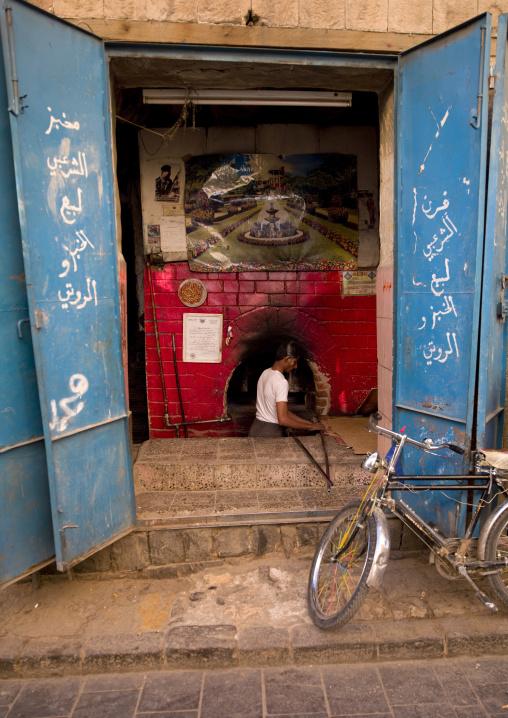 Baker Working In Front Of His Bright Red Oven Sanaa, Yemen
