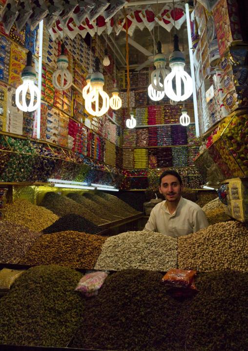 Smiling Shop Keeper Among Piles Of Snacks, Sanaa's Souq, Yemen