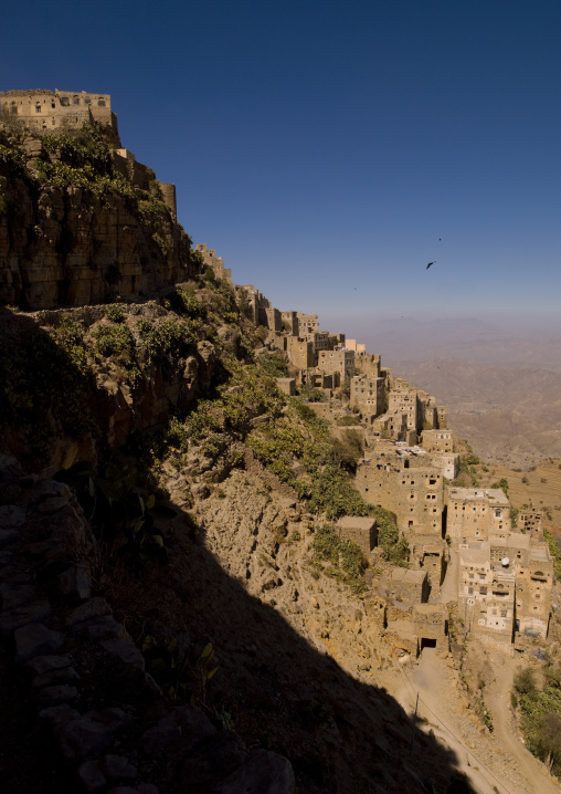 Village Of Kholan Merging With The Mountain Over The Cultivated Terrace, Kholan, Yemen