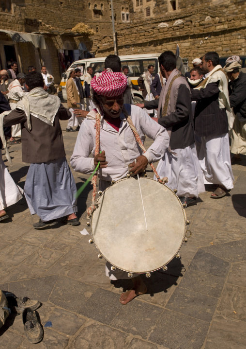 Man Playing Drum At A Wedding In Thula, Yemen