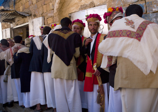 Grooms With Traditional Turbans Decorated With Flowers Standing In Line During A Wedding, Thula, Yemen