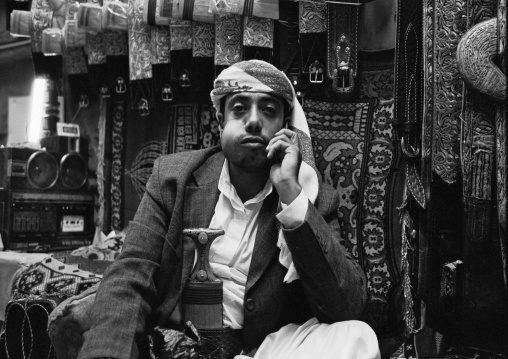 Man Chewing Qat While Waiting For A Phone Call In A Shop, Sanaa, Yemen