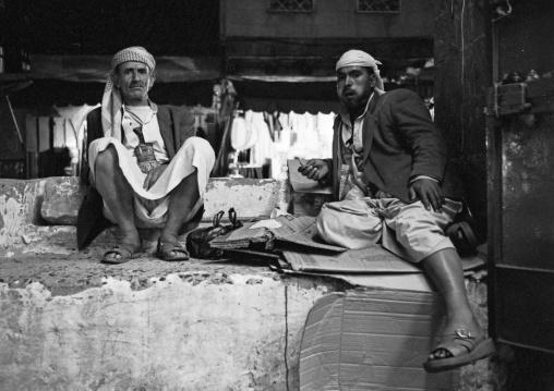 Two Men Chewing Qat While Relaxing, Black And White, Sanaa, Yemen