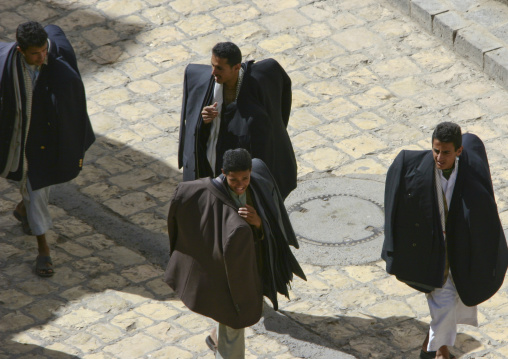 Clothes Sellers Passing By With All Their Stock In The Souq, Sanaa, Yemen