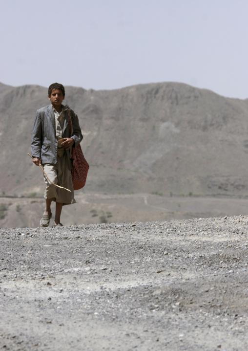 Boy Walking On The Desert, Yemen