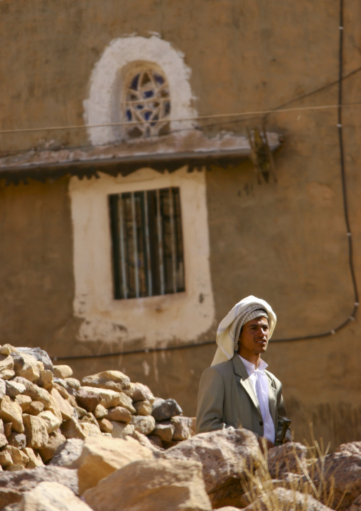 Young Man Passing Behind A Heap Of Stones, Ina, Yemen