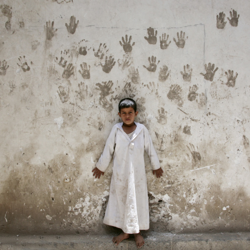 Child In Front Of A Wall Covered With Handprints To Protect From The Evil Eye, Sanaa, Yemen