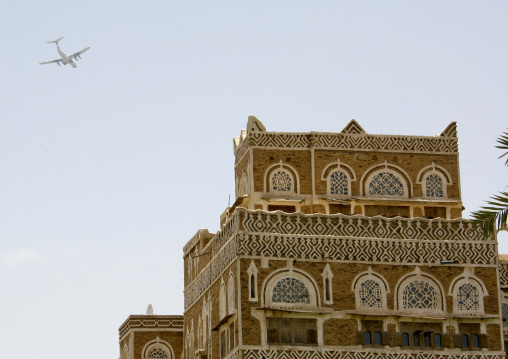 Plane Passing Over A House In Sanaa, Yemen