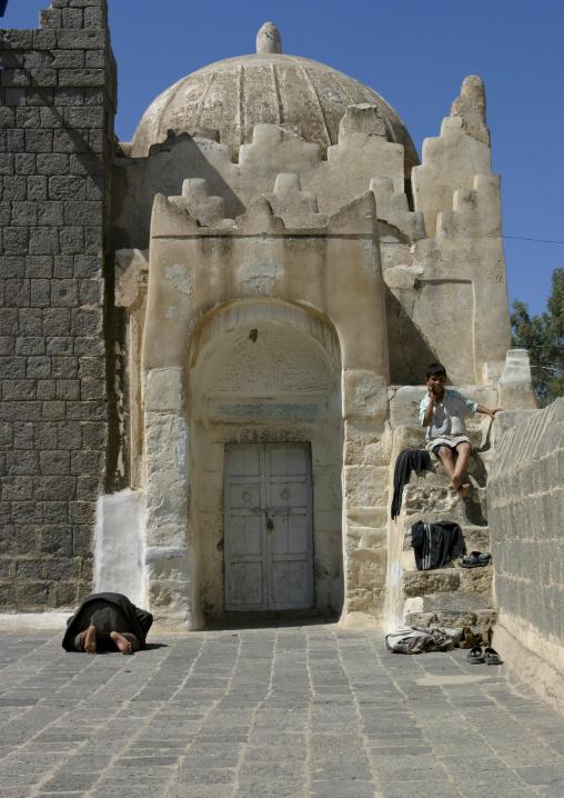 Man Praying And Boy Sitting On Stairs In Dhamar, Yemen