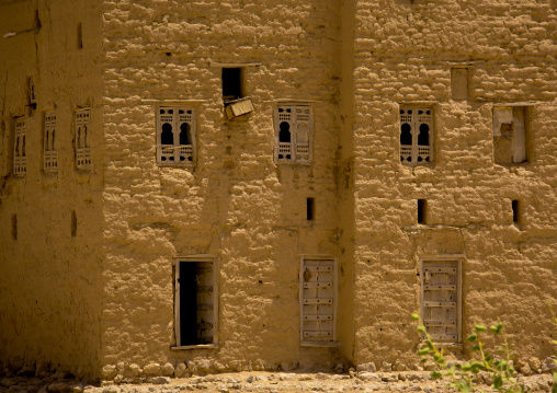 Facade Of A Traditional Mud Building With Wooden Carved Windows, Hadramaut, Yemen
