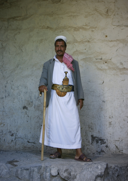 Man Wearing A Dagger Or Jambia And Standing Proud With  A Cane, Yafrus, Yemen
