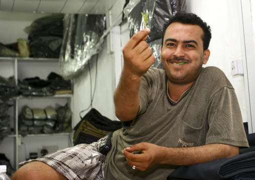 Smiling Man In His Shop Showing A Leaf Of Qat While Chewing, Al Hodeidah Souq, Yemen