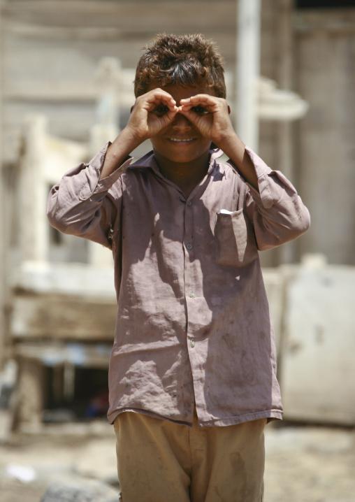 Boy Mimicing Binoculars With His Hands, Mocha, Yemen