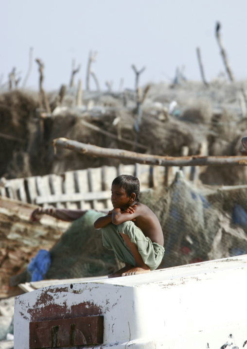 Dreaming Boy Squatting In Al Khukaha Harbor, Yemen